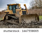 Dirty Bulldozer Standing In The ...