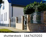 Wrought Iron Fence And Green...