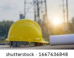 Hard hat placed on the barrier platform. On the construction and development areas - stock photo