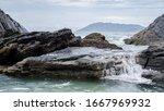 Waves Breaking On The Rocks On...