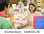 shopping in a textile market | Shutterstock . vector #166816178