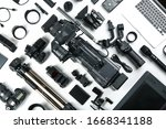 Flat lay composition with video camera and other equipment on white background - stock photo