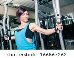 young woman in sport dress in a ...   Shutterstock . vector #166867262
