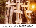 empty wooden signposts with... | Shutterstock . vector #1668760168