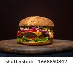 Beef Burgers On Wooden Plate