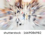 Small photo of Many anonymous hectic people in the pedestrian area of ??a city