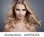 beautiful young woman with... | Shutterstock . vector #166926326