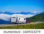 Small photo of VIKAFJELLET, NORWAY - JULY 5, 2018: Cabby trailer caravan on road across Vikafjellet between Vinje - Vik in Stolsheimen mountains area western Norway.