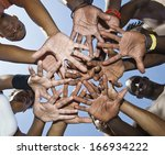a group of mixed race people... | Shutterstock . vector #166934222