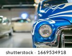 Vintage car front  with chrome trim and sporty theme - stock photo