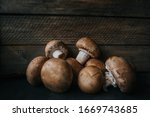 Champignon Mushrooms On Wooden...