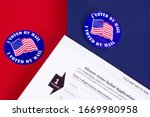 Small photo of Absent voter ballot application. I voted by mail sticker. Absentee forms.