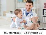 Pediatrician Examining Little...