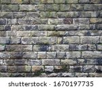 An Old Grey Damp Stone Wall...