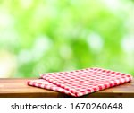 Red Checked Tablecloth On Wood...