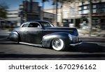 Old  Matte Black Car Driving...