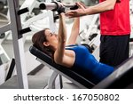 cute young woman lifting a... | Shutterstock . vector #167050802