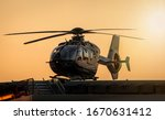 Black Helicopter Tied Down On...