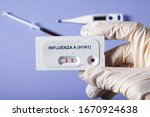 Doctor Holding A Test Kit For...