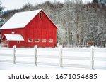 A Red Barn And Barnyard...