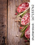 italian salami sliced on wooden ... | Shutterstock . vector #167153762