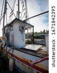 Rustic Fishing Boat Docked In...