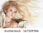 beautiful blond woman in fur... | Shutterstock . vector #167209586