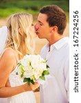 bride and groom  kissing at... | Shutterstock . vector #167224256