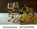 white wine in glass against... | Shutterstock . vector #1672394998