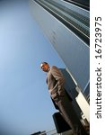 an african american business man outside of his office building - stock photo