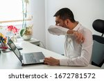 Young Business Man Sneezing....