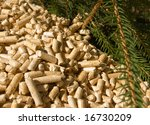 wood pellets and branches of red deal - stock photo