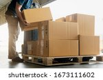 Worker Courier Lifting Package...