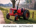 Old Red Vintage Tractor On The...