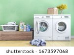 laundry room with green wall... | Shutterstock . vector #1673597068