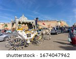 Small photo of Meknes, Morocco - 10.11.18: View of a random touristic wagon / coach at the Grand Taxi spot next to the Lahdim Square. Typical kitschy vehicles drawing attention to themselves by the decorations