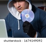 Young Hacker Hacking Into...