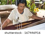 Old Women Weaving Traditional...