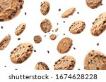 Small photo of Collection of half chocolate chip cookies on white background