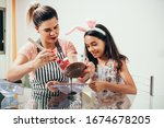 Mother And Daughter Making...