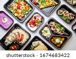 Small photo of Catering food with healthy balanced diet delicious lunch box boxed take away deliver packed ready meal in black container dinner, meal, brakfast