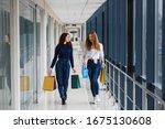 two girl friends on shopping... | Shutterstock . vector #1675130608