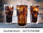 Three cola glass with ice cubes ...
