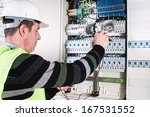 electrician checking a fuse box | Shutterstock . vector #167531552