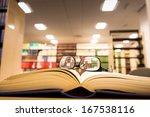 A Book Lying On The Bookshelf...
