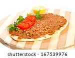 turkish pizza on a wooden board | Shutterstock . vector #167539976