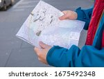 Tourist Holding A Paper Map In...