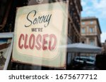 "Small photo of ""Sorry we're closed"" shop window door sign board,abandoned closed shut down cafe restaurant business,Coronavirus COVID-19 virus disease global pandemic crisis,isolation quarantine lockdown concept,USA"