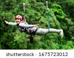 mature visitor wearing informal suit on zipline trip selective stress against misty jungle excursion race zipline canopi vacation vegetation canopy outdoor expedition feminine rainforest ecuador fores
