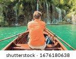 Rear view of man paddling...